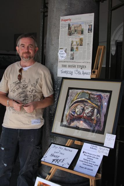 Artist Daniel Lenihan with his painting 'Capital Heads'